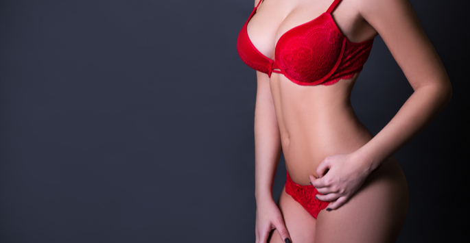 Augmented Breast patient posing in red lingerie