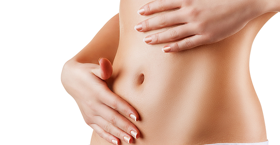 Woman touching her smooth stomach