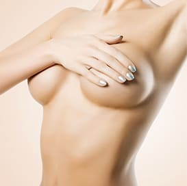 Woman grasping left breast