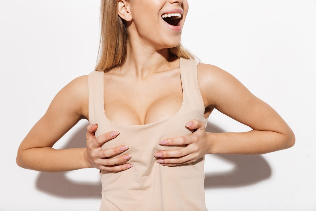 Woman Holding Breasts with pide through tanktop